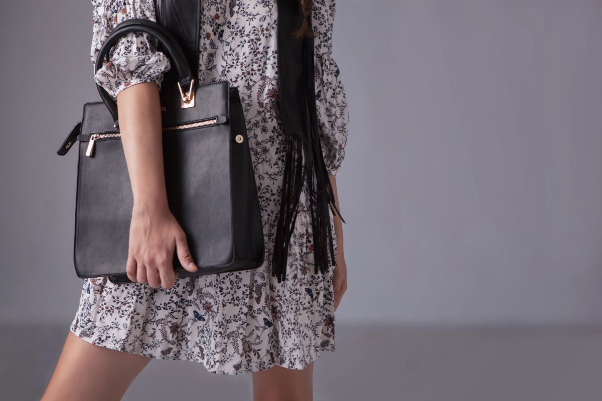 Fashionable woman with black leather bag